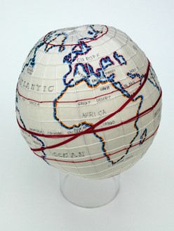 Stitch your globetrotter's route onto a globe or paper travel map